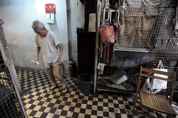 "perierga.gr - Οι ""άνθρωποι των κλουβιών"" στο Χονγκ Κονγκ!"
